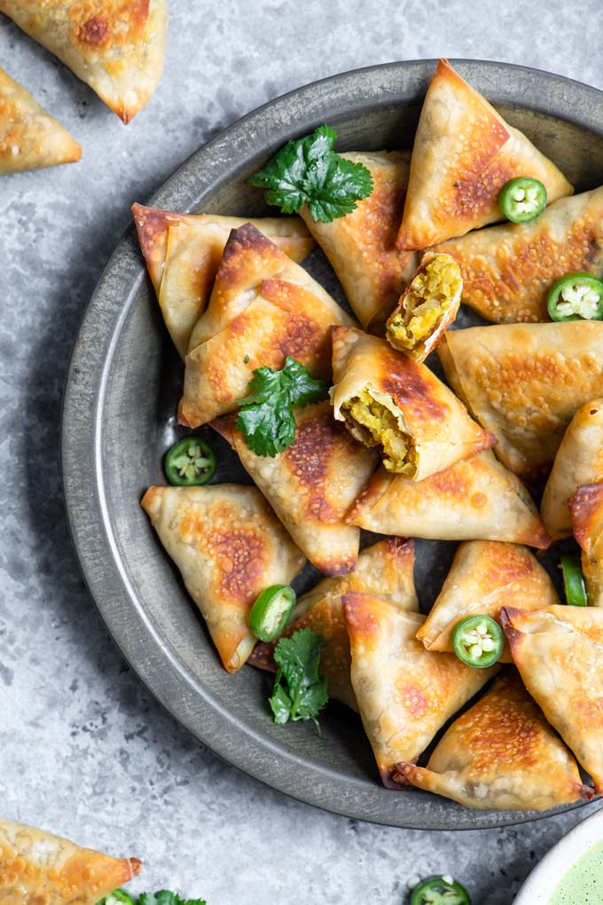 close up of baked samosa with one cut in half