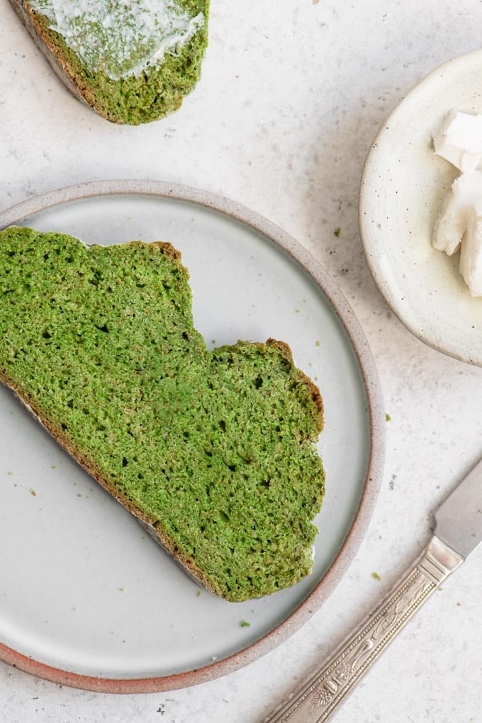 a slice of green bread on a plate