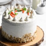 carrot cake decorated with vegan cream cheese frosting