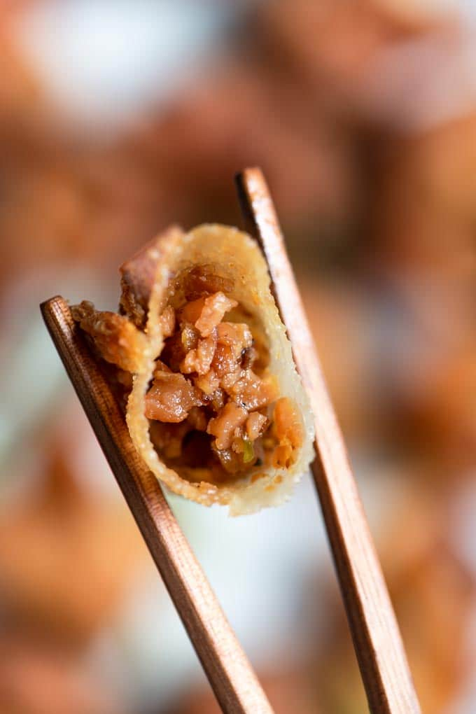 bite shot of vegan wontons, showing filling