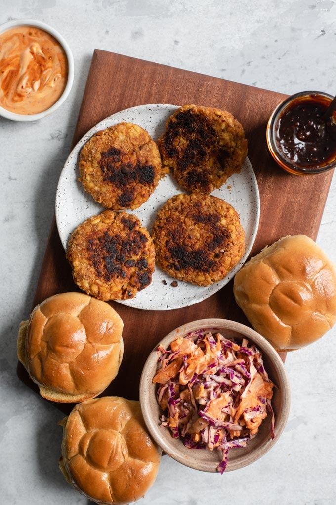 everything you need for korean bbq burgers: tempeh patties, kimchi slaw, korean BBQ sauce, and vegan buns