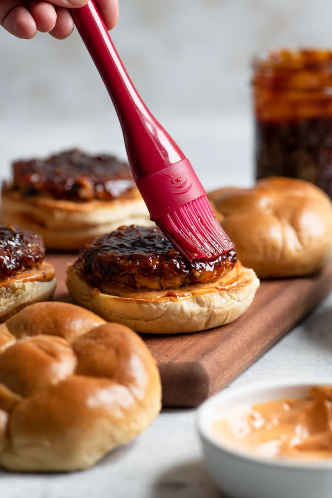 brushing korean BBQ glaze on burgers
