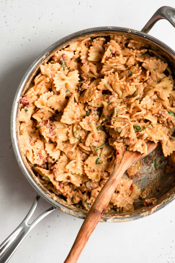 bowtie pasta tossed in sun dried tomato cream sauce in a pot