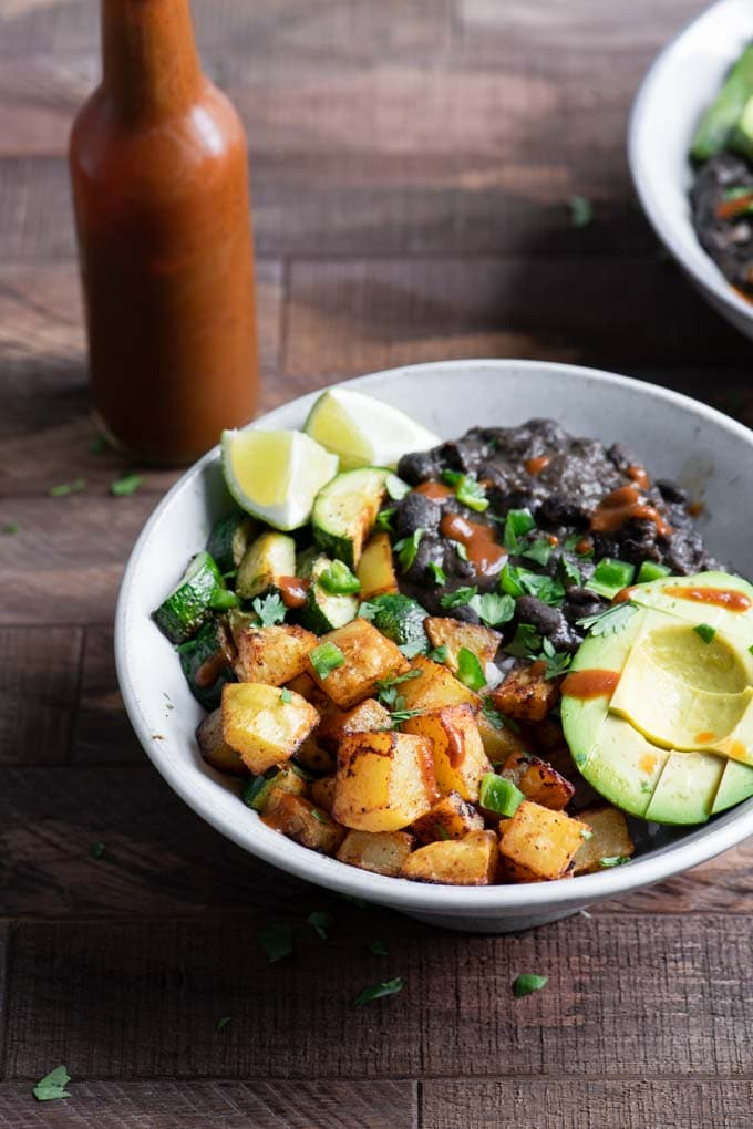 black bean bowl served with hot sauce