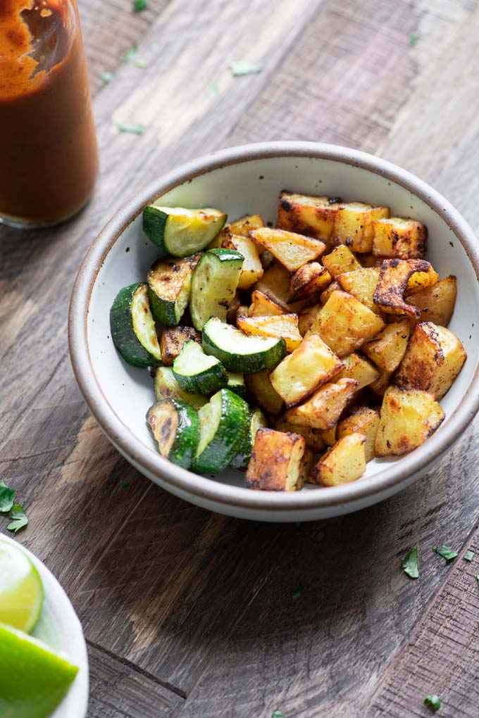 roasted potato and pan fried zucchini in a bowl