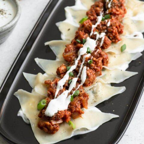 vegan aushak with extra yogurt sauce drizzled on top