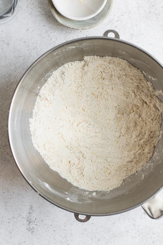 vegan butter after it has been rubbed into the dry ingredients to show the crumbly texture