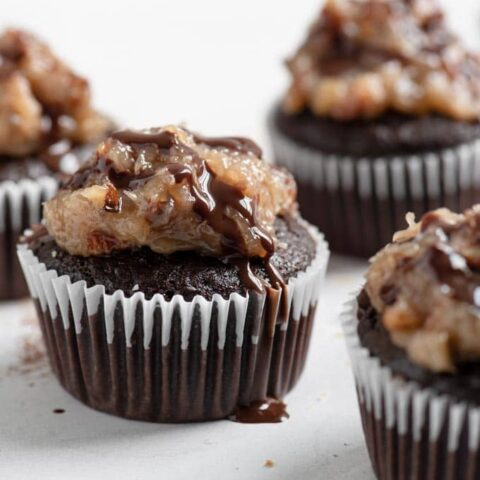 a cupcake with a chocolate drizzle