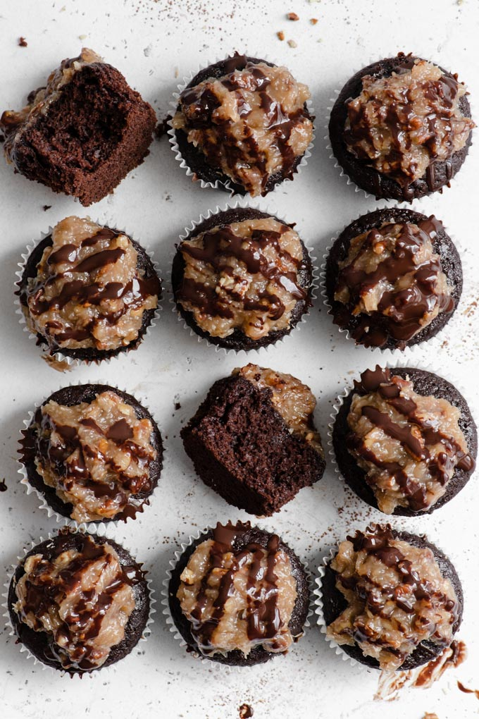 vegan german chocolate cupcakes from above with two on their sides with bites taken out of them