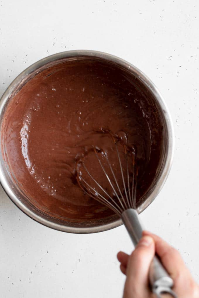 whisking vegan chocolate cake batter