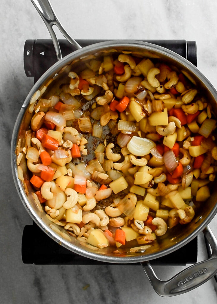 cashews and vegetables sautéd in the pot