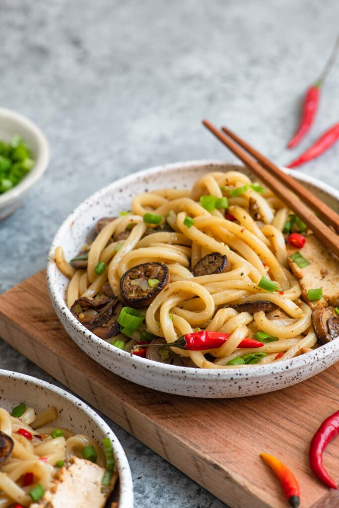sichuan noodles served in a bowl