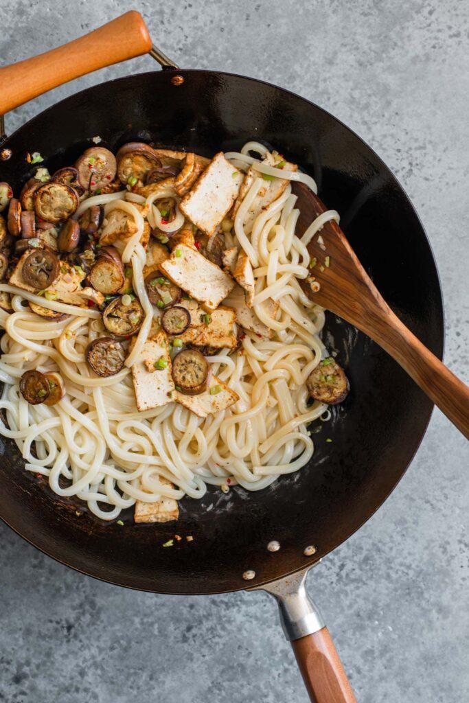 noodles, eggplant, and tofu added to wok