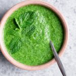 homemade cilantro chutney garnished with mint leaves