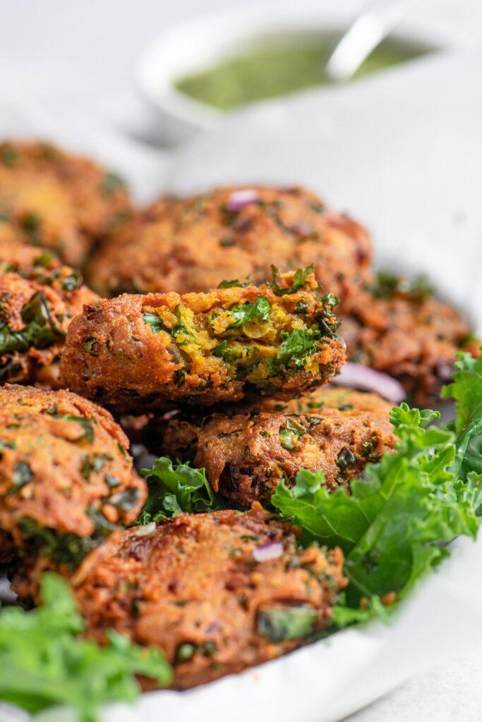 bite shot of kale pakoras