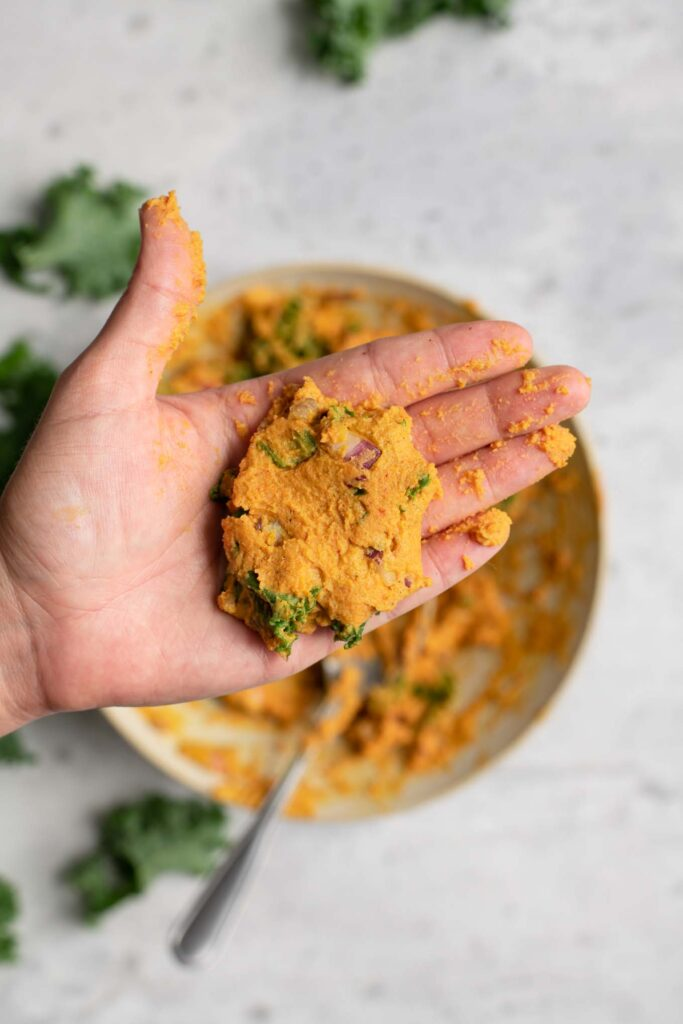 shaped pakora batter in the palm of a hand