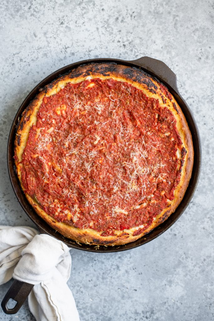 chicago-style deep dish pizza baked in a cast iron skillet