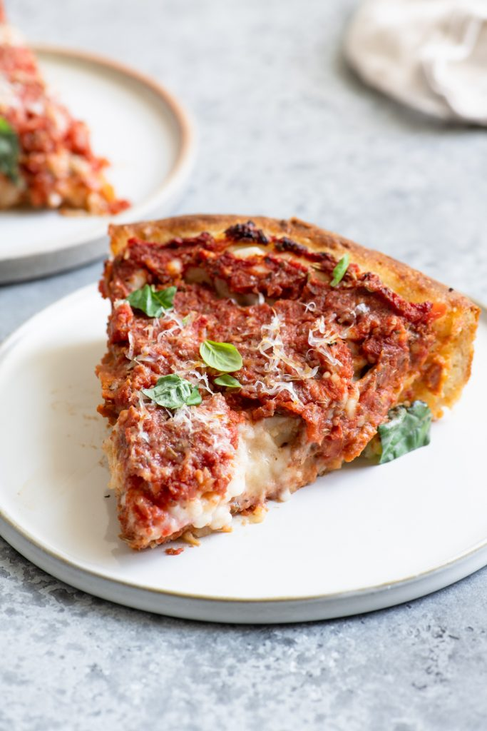 slices of deep dish pizza on a plate
