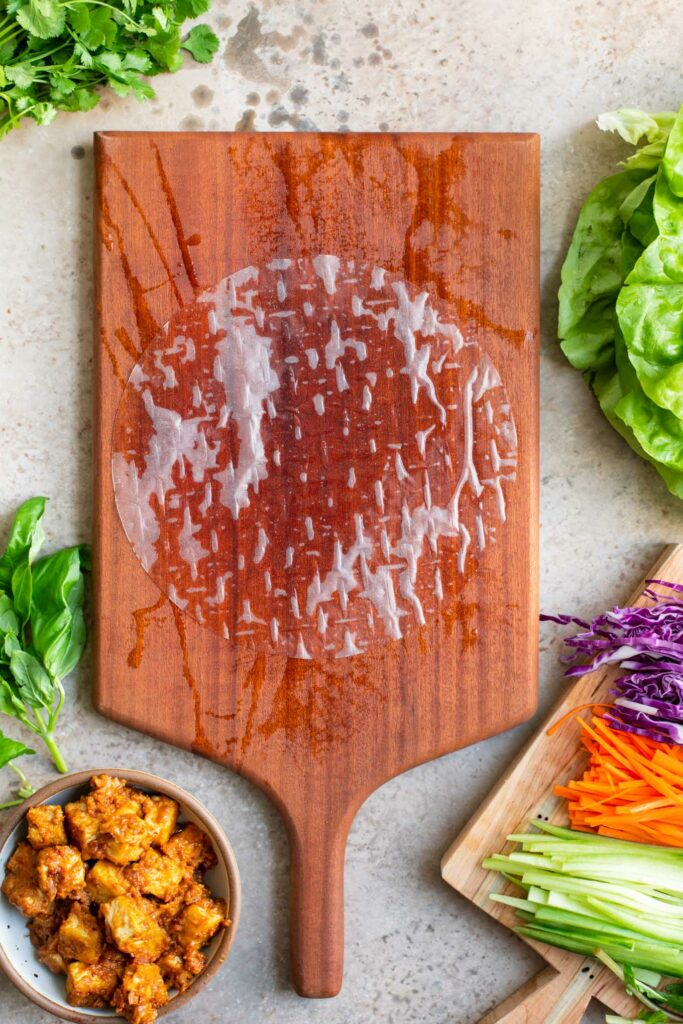 dampened rice paper wrap on damp cutting board