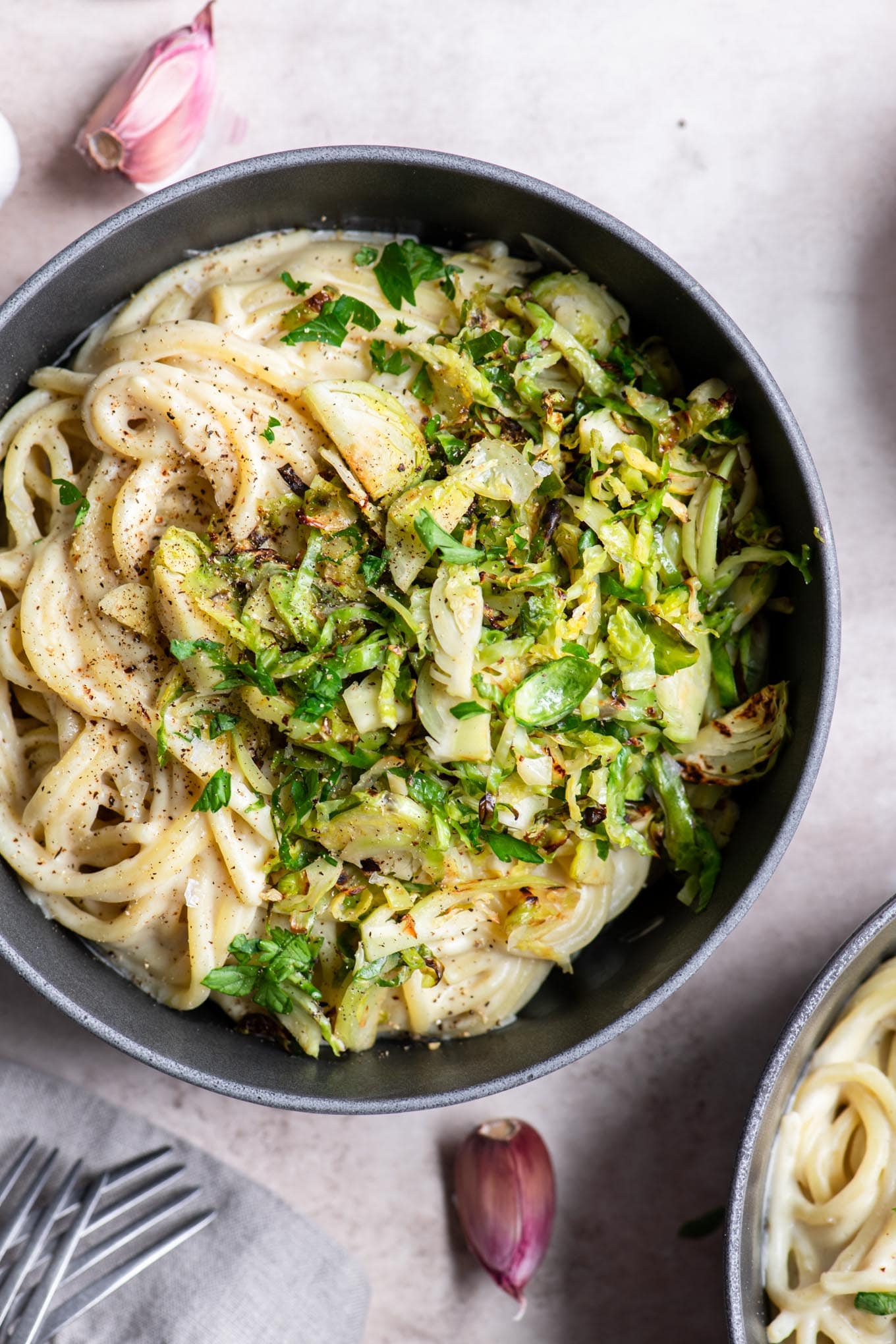 vegan creamy garlic spaghetti with Brussels sprouts in a bowl