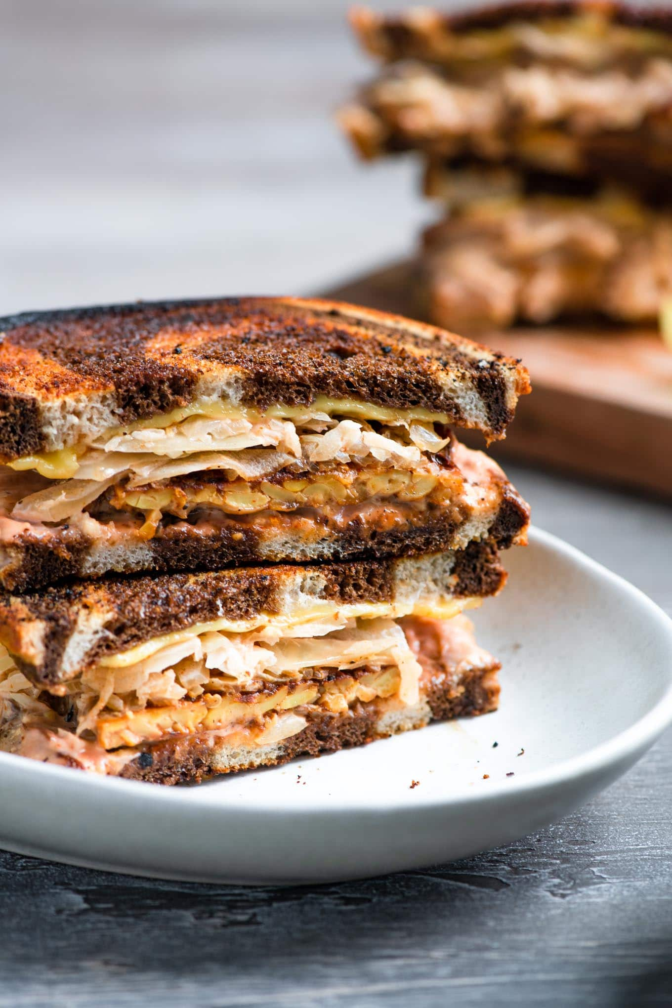vegan reuben sandwich assembled on a plate