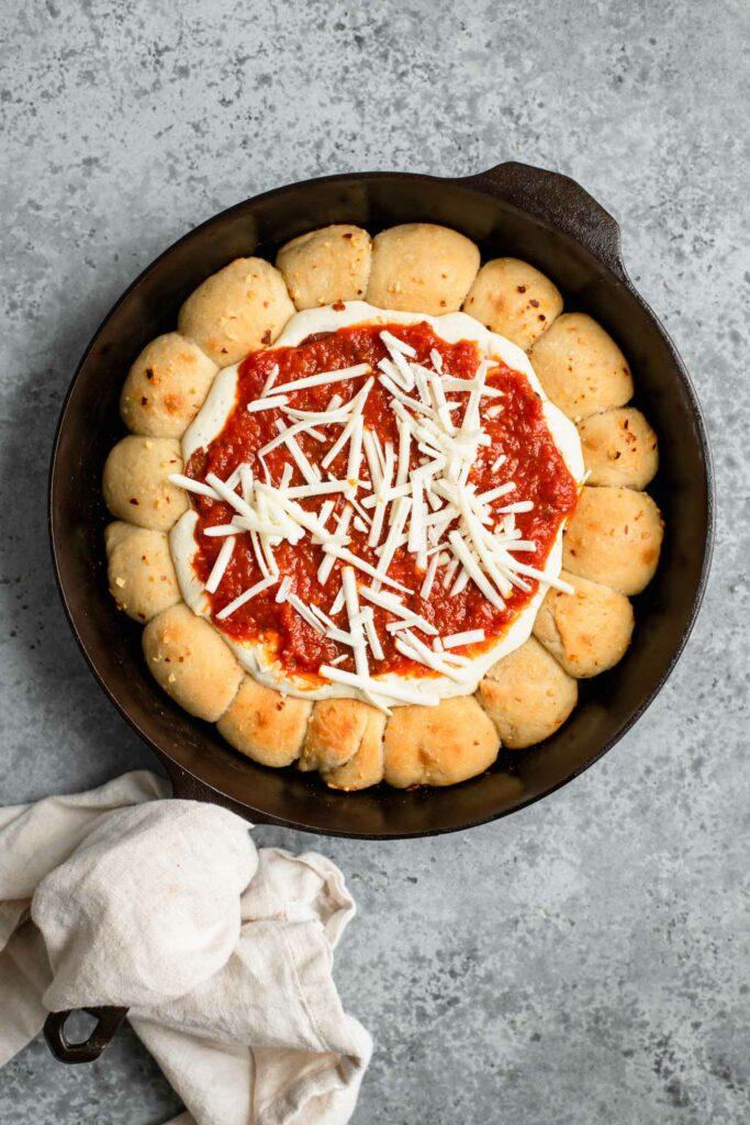some vegan mozzarella sprinkled over sauce