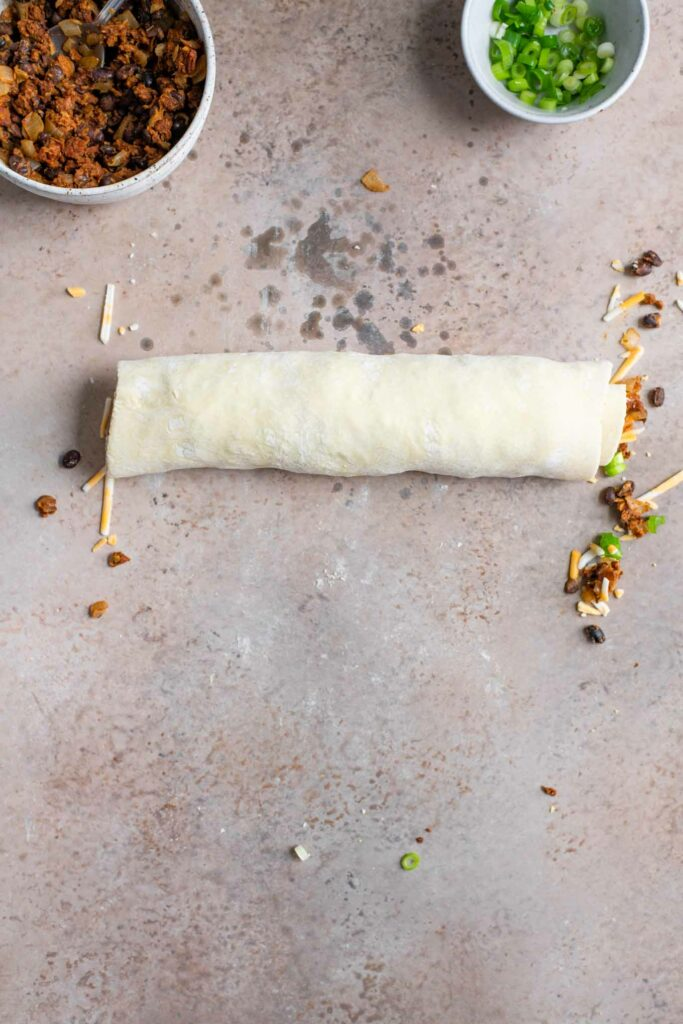 the finished roll of mexican taco filled puff pastry