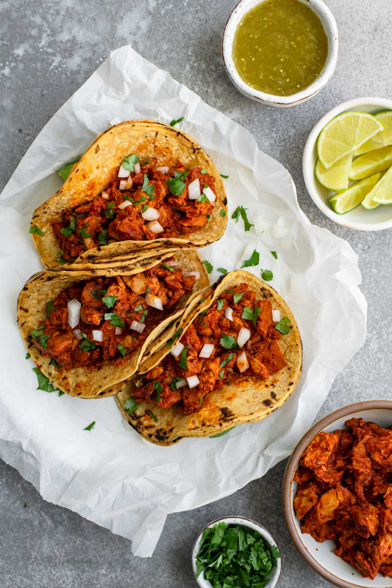 vegan barbacoa tacos topped with minced onion and cilantro