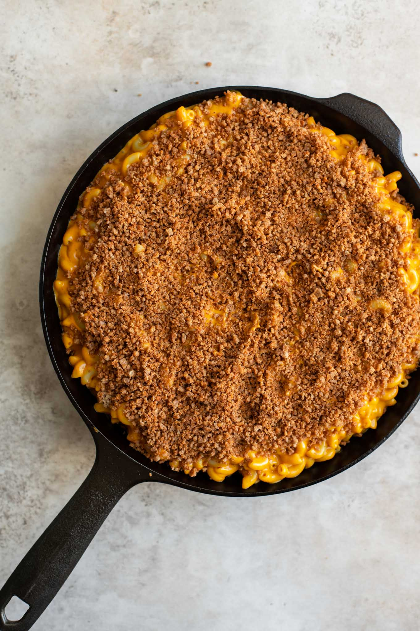 injera crumb topped berbere mac and cheese before baking