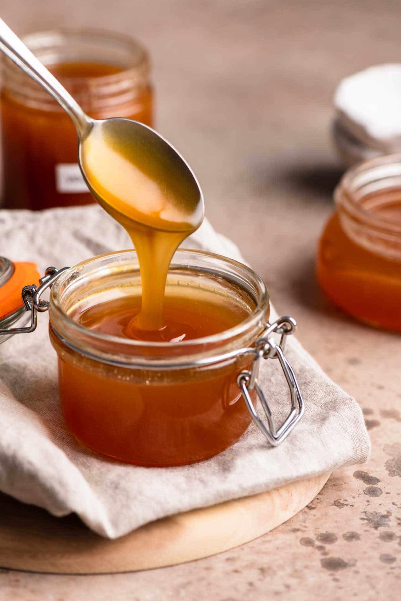 vegan caramel sauce in three glass jars