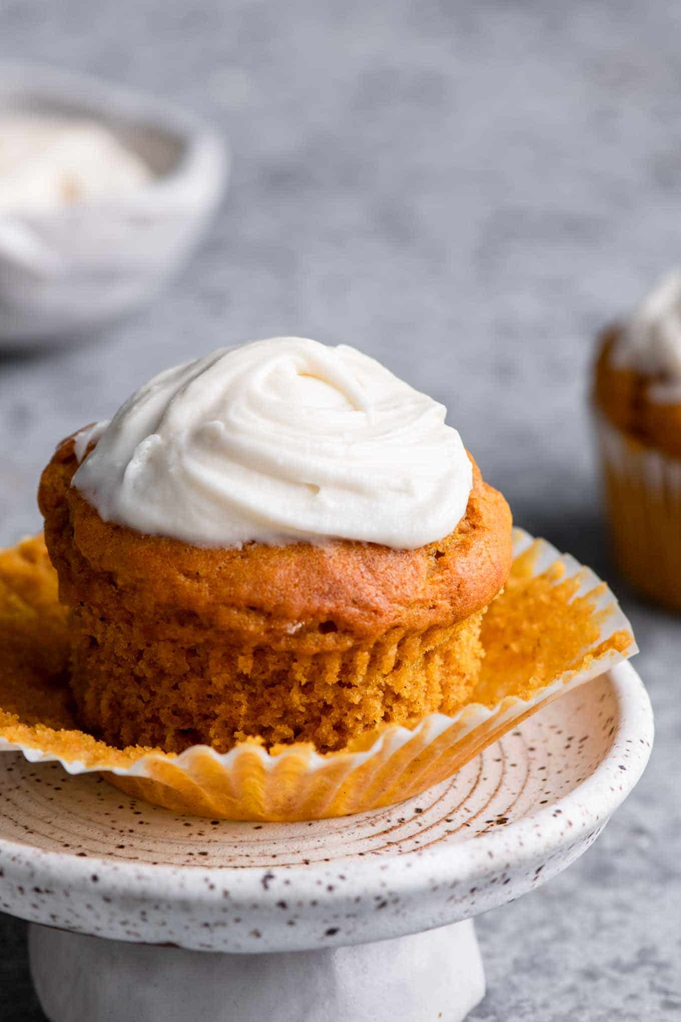 pumpkin muffin with wrapper peeled off