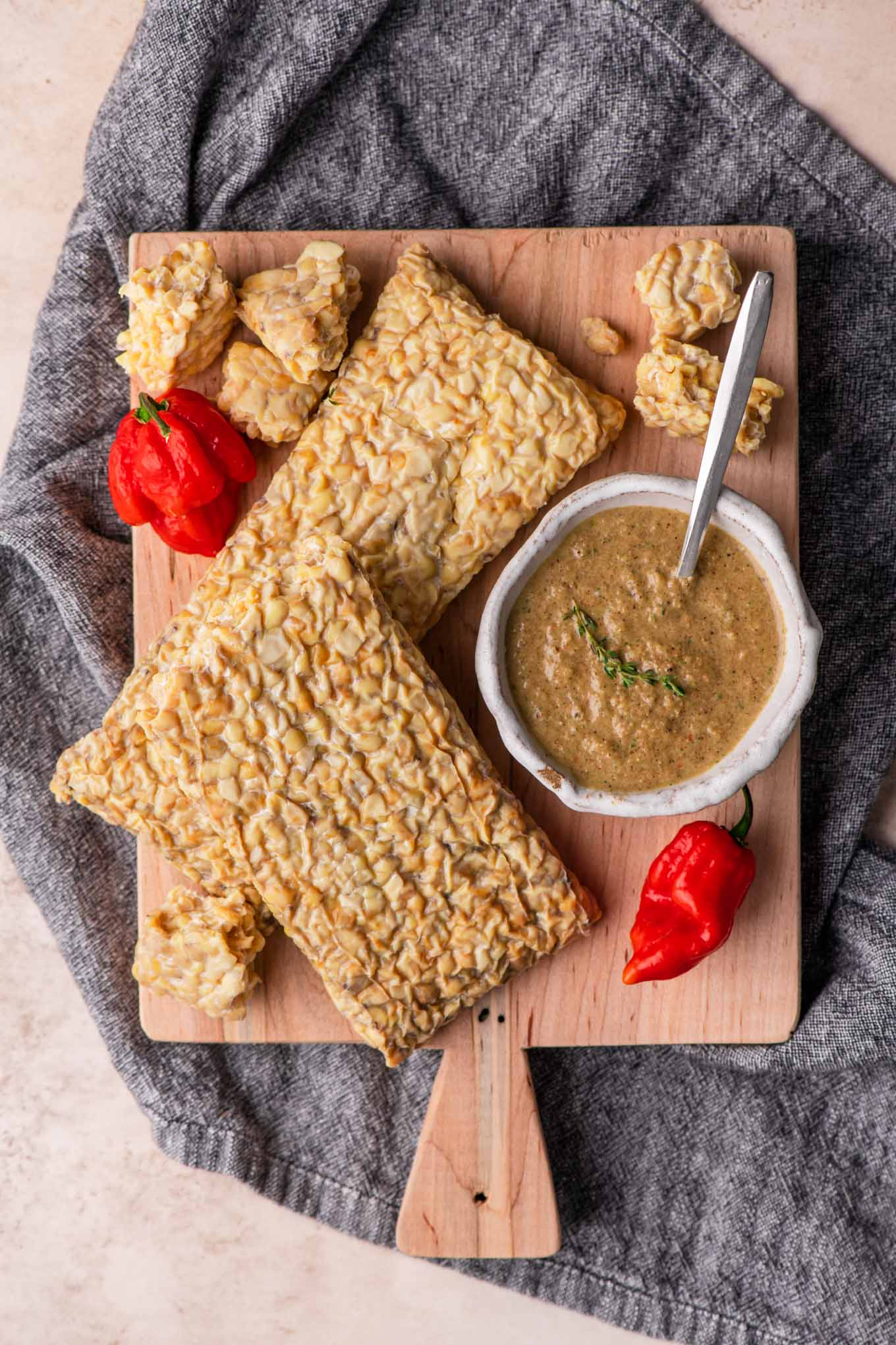 tempeh and jerk sauce on a cutting board