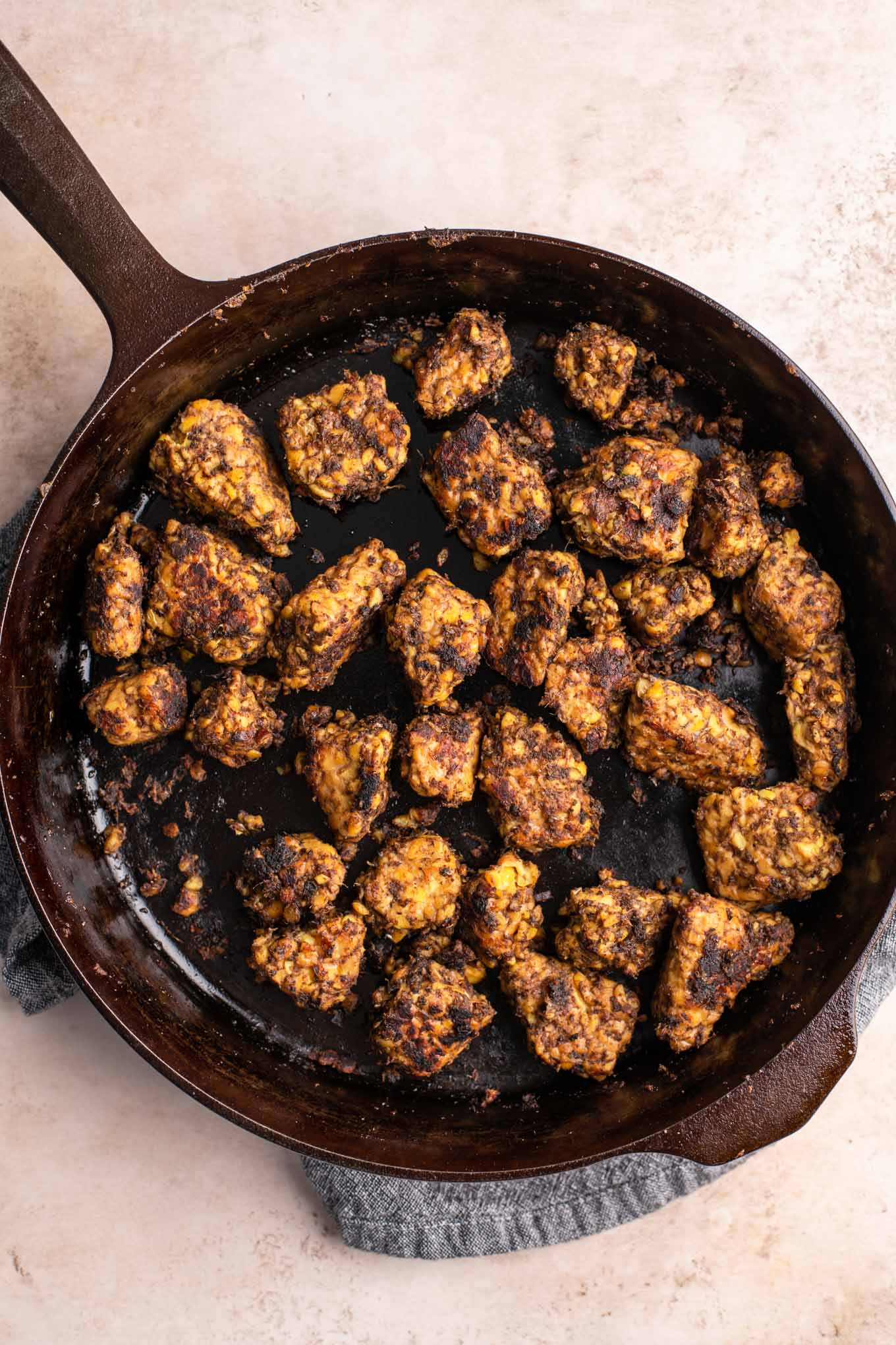 jerk tempeh cooked in a cast iron skillet