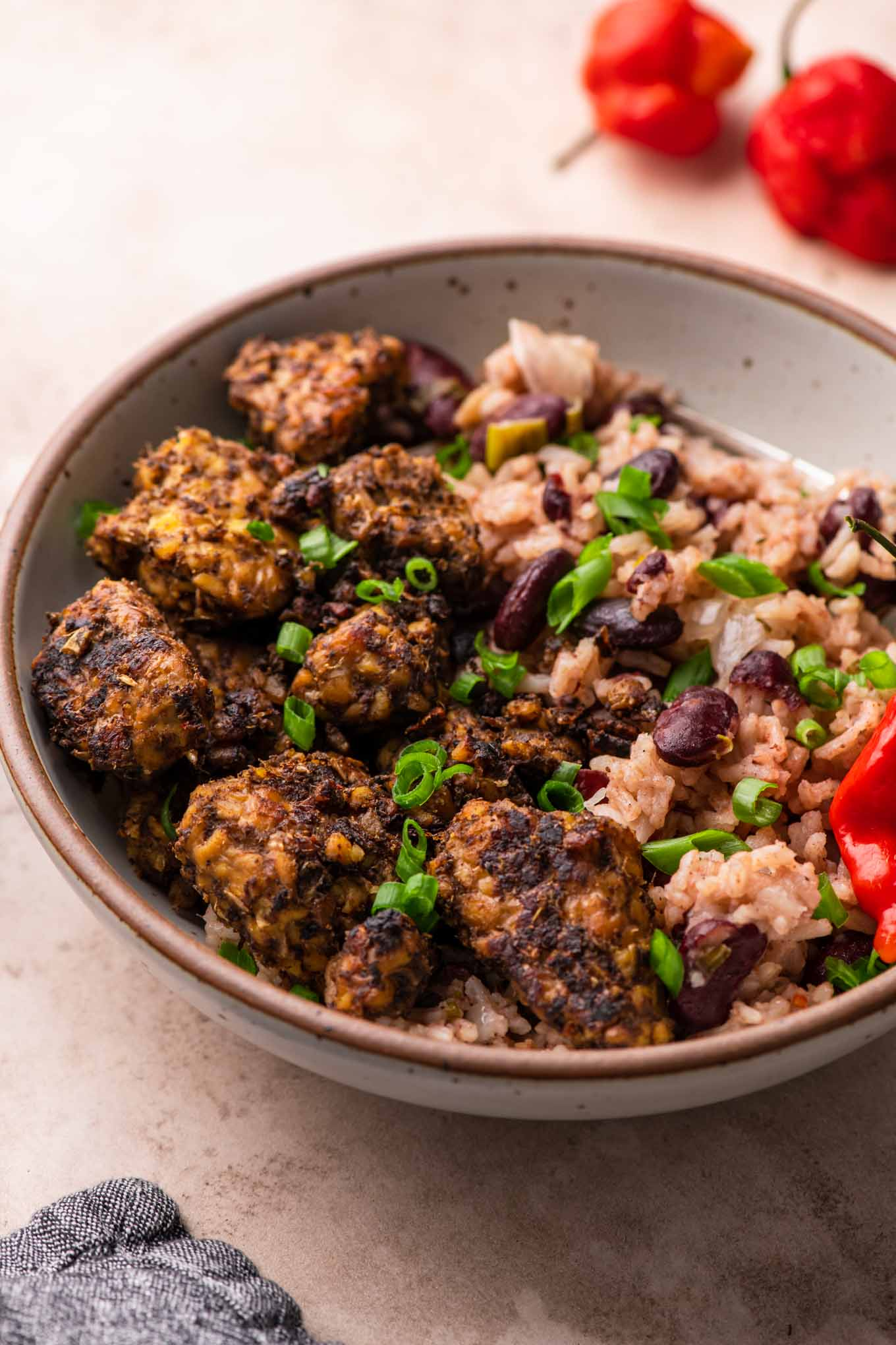 jamaican jerk tempeh served with red beans and rice
