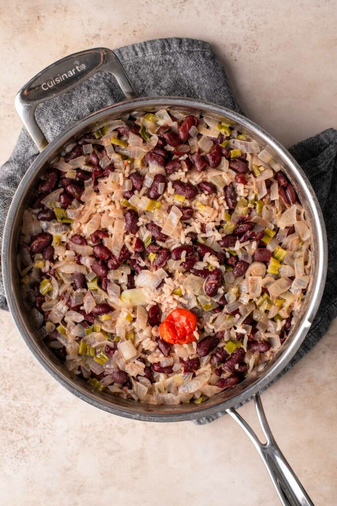 cooked red rice and beans before fluffing