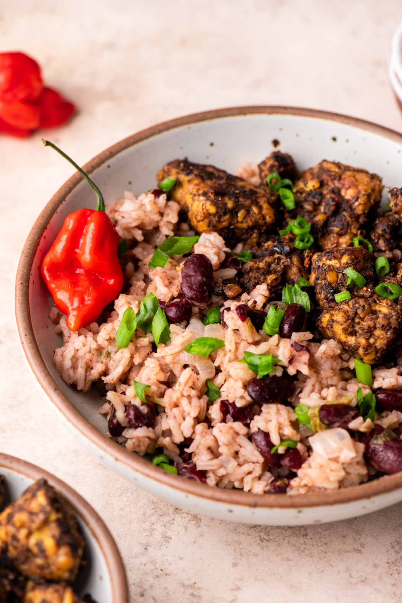 jamaican red beans and rice in a bowl with jerk tempeh